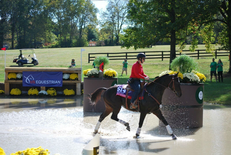 Nates Mineshaft and Shannon Reed tackle a water obstacle at the Thoroughbred Makeover
